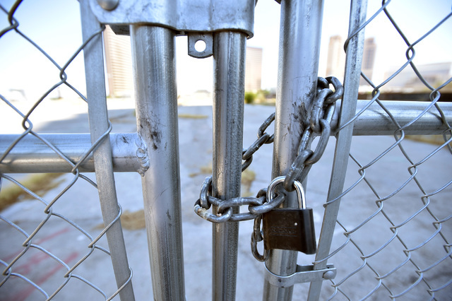 A locked gate is seen at an entrance to the construction site of the planned $2 billion Alon project on the Strip north of Spring Mountain Road on Monday, Aug. 29, 2016, in Las Vegas. (David Becke ...