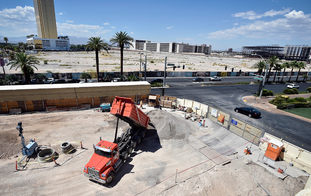 A dump truck is seen emptying its load of material at the Wynn Las Vegas retail expansion site across the Strip from the planned $2 billion Alon project Monday, Aug. 29, 2016, in Las Vegas. (David ...