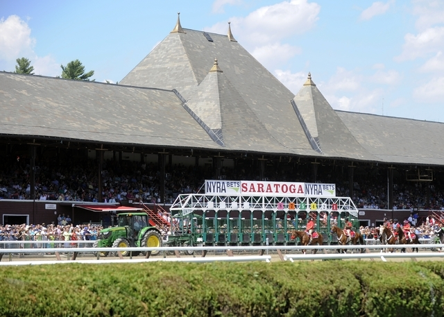 Crews move a starting gate past the grandstand after the fourth race on opening day of the season at Saratoga Race Course in Saratoga Springs, N.Y., Friday, July 22, 2016. (Hans Pennink/AP)
