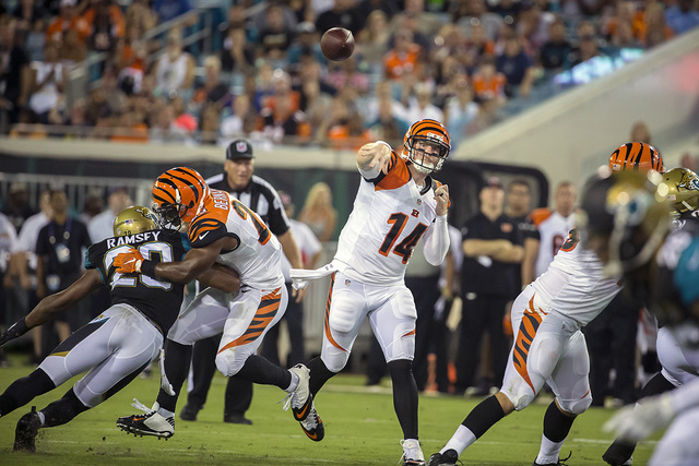 Cincinnati Bengals quarterback Andy Dalton (14) throws a pass against the Jacksonville Jaguars during the first half of an NFL preseason football game in Jacksonville, Fla., Sunday, Aug. 28, 2016. ...