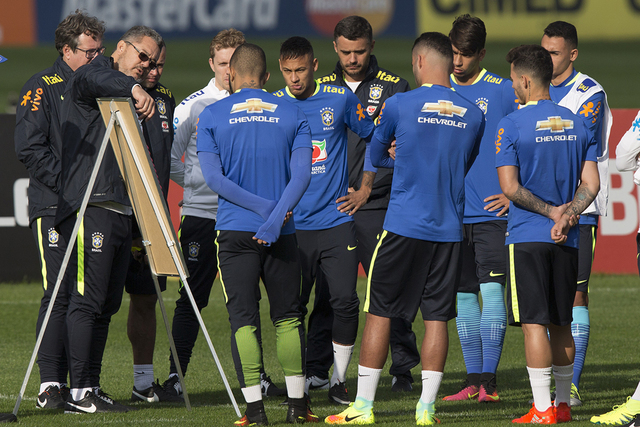 Brazil's coach Rogerio Micale, left, gives instructions to his players during a practice session at the Granja Comary training center ahead of the Olympic games in Teresopolis, Brazil, Tuesday, Ju ...