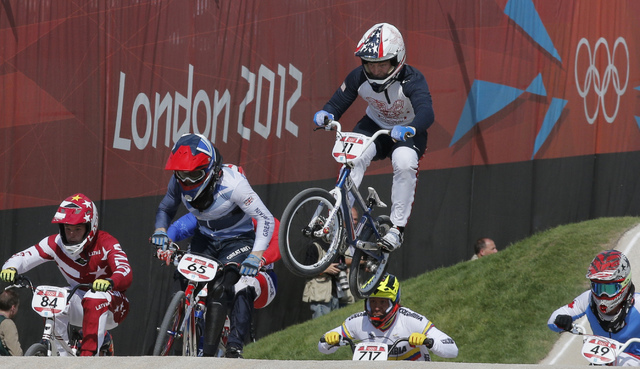 United States' Connor Fields (11) leads the competition in a BMX cycling men's quarterfinal run during the 2012 Summer Olympics in London, Aug. 9, 2012. (Christophe Ena, File/AP)