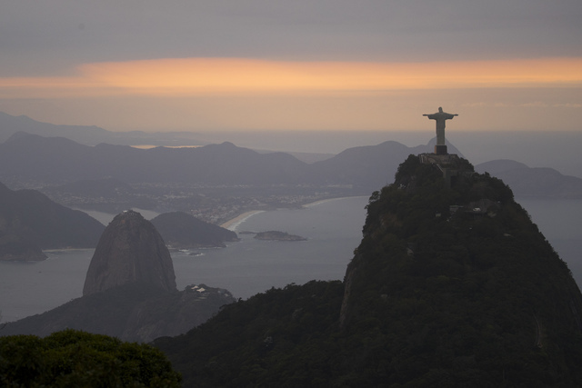 The Christ the Redeemer statue and Sugar Loaf mountain stand as the sun rises in Rio de Janeiro, Brazil, Thursday, Aug. 4, 2016. The 2016 Summer Olympics is scheduled to open Aug. 5. (Felipe Dana/AP)