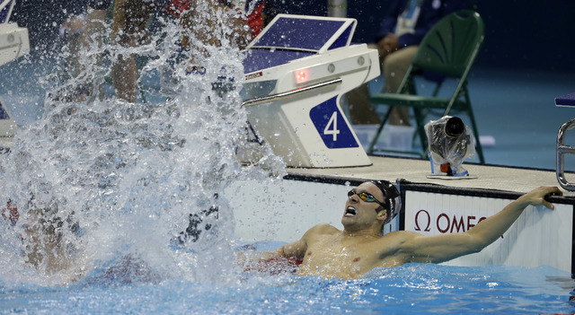 United States' Cody Miller celebrates winning the bronze medal in the men's 100-meter breaststroke during the swimming competitions at the 2016 Summer Olympics, Sunday, Aug. 7, 2016, in Rio de Jan ...