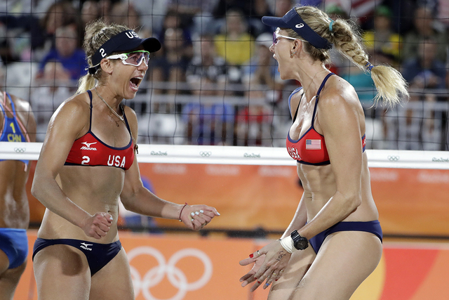United States' April Ross, left, and Kerri Walsh Jennings celebrate a point over China during a women's beach volleyball match at the 2016 Summer Olympics in Rio de Janeiro, Brazil, Tuesday, Aug.  ...