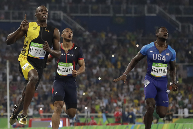 Bolt wins unprecedented third Olympic gold in 100-meter ...