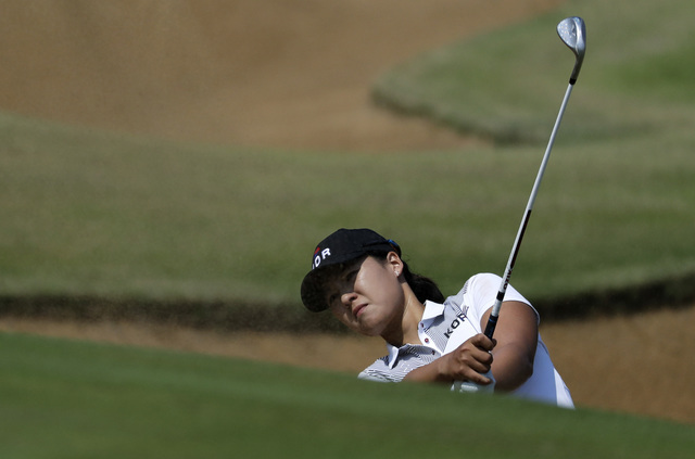 Inbee Park, a Bishop Gorman alum, hits out of a bunker onto the third green during the third round at the 2016 Summer Olympics in Rio de Janeiro, Friday, Aug. 19, 2016. (Chris Carlson/AP)