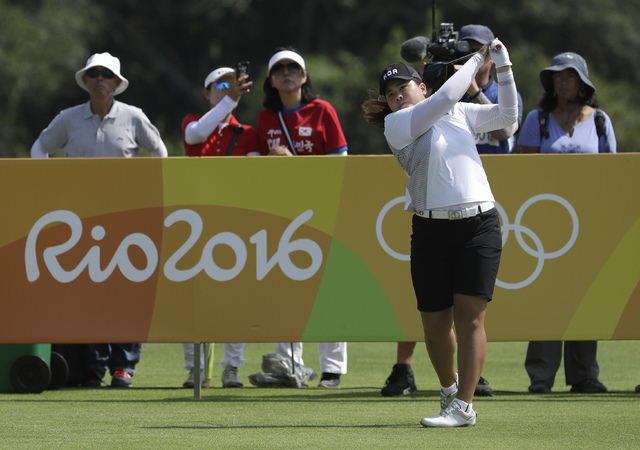 Inbee Park of South Korea watches her tee shot on the third hole during the third round at the 2016 Summer Olympics in Rio de Janeiro, Friday, Aug. 19, 2016. (Alastair Grant/AP)