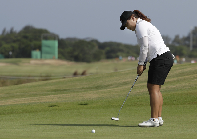 Inbee Park of South Korea putts on the ninth hole during the third round of the women's golf event at the 2016 Summer Olympics in Rio de Janeiro, Friday, Aug. 19, 2016. (Alastair Grant/AP)