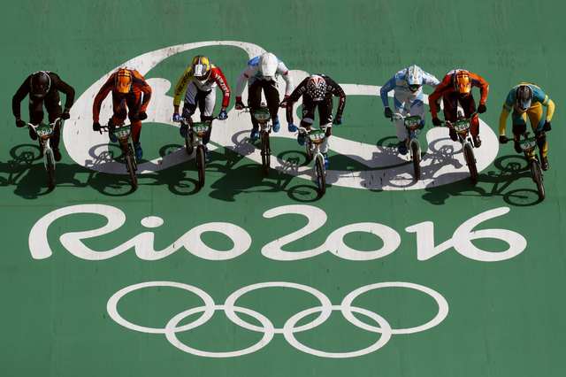 Cyclists, from right, Sam Willoughby of Australia, Twan van Gendt of the Netherlands, Gonzalo Molina of Argentina, Connor Fields of the United States, Tory Nyhaug of Canada, Jefferson Milano of Ve ...