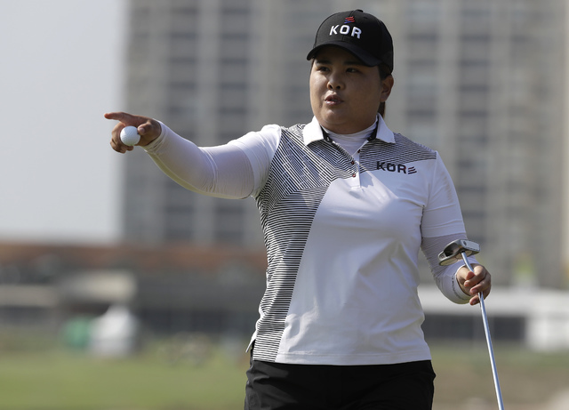 Inbee Park of South Korea gestures after putting the 10th hole during the third round of the women's golf event at the 2016 Summer Olympics in Rio de Janeiro, Friday, Aug. 19, 2016. (Alastair Gran ...