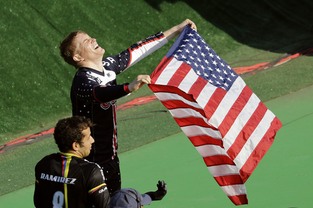 Connor Fields of the United States, top, celebrates after winning gold in the men's BMX cycling final next to third placed Carlos Ramirez Yepes of Colombia, bottom, during the 2016 Summer Olympics ...