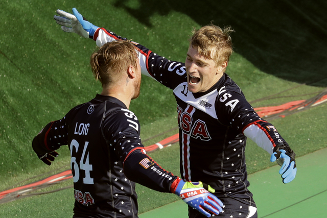 First placed Connor Fields, right, celebrates with third placed Nicholas Long, both of the United States, left, after the men's BMX cycling final during the 2016 Summer Olympics in Rio de Janeiro, ...
