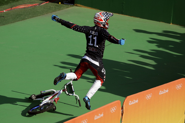 Connor Fields of the United States celebrates after winning gold in the men's BMX cycling final during the 2016 Summer Olympics in Rio de Janeiro, Brazil, Friday, Aug. 19, 2016. (Victor R. Caivano/AP)