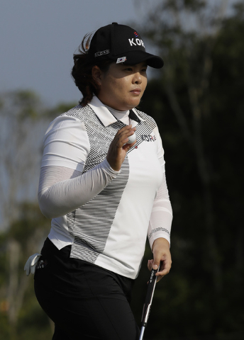 Inbee Park of South Korea walks away after putting on the 13th hole during the third round of the women's golf event at the 2016 Summer Olympics in Rio de Janeiro, Brazil, Friday, Aug. 19, 2016. ( ...