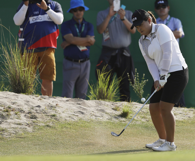 Inbee Park of South Korea attempts to reach the 14th green during the third round of the women's golf event at the 2016 Summer Olympics in Rio de Janeiro, Friday, Aug. 19, 2016. (Alastair Grant/AP)