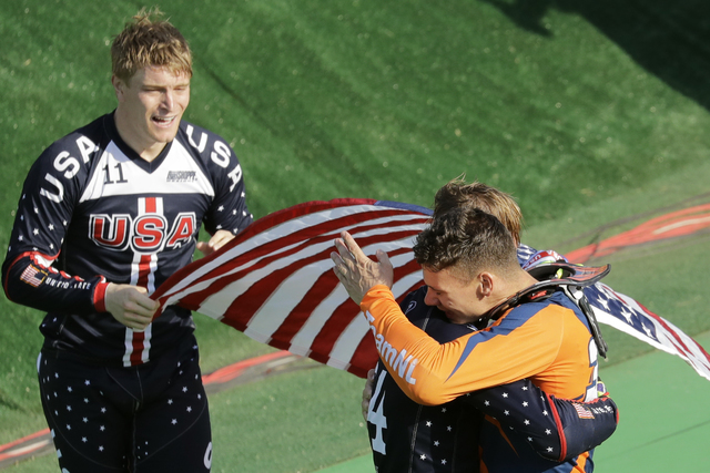 Third placed Nicholas Long of the United States, center, hugs with second placed Jelle van Gorkom of the Netherlands, right, as first placed Connor Fields of the United States, left, looks on afte ...