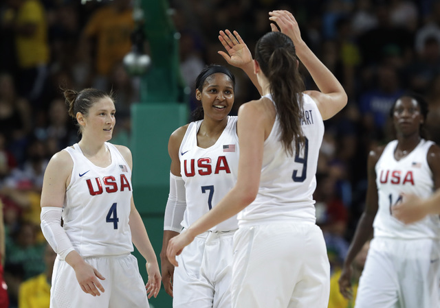 United States' Lindsay Whalen (4) and Maya Moore (7) celebrates with teammate United States' Breanna Stewart (9) during a women's gold medal basketball game against Spain at the 2016 Summer Olympi ...