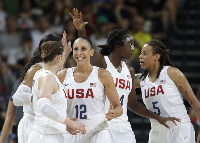 United States' Diana Taurasi (12) celebrates with teammates during a women's gold medal basketball game against Spain at the 2016 Summer Olympics in Rio de Janeiro, Brazil, Saturday, Aug. 20, 2016 ...