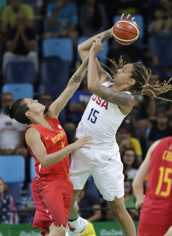 United States' Brittney Griner (15) shoots over Spain's Laura Nicholls (4) during a women's gold medal basketball game at the 2016 Summer Olympics in Rio de Janeiro, Brazil, Saturday, Aug. 20, 201 ...