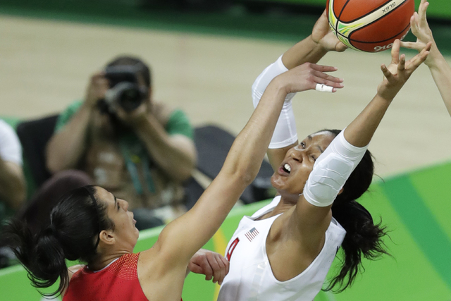 United States' Maya Moore, right, grabs a rebound over Spain's Leticia Romero, left, during the gold medal basketball game at the 2016 Summer Olympics in Rio de Janeiro, Brazil, Saturday, Aug. 20, ...