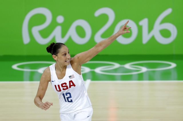United States' Diana Taurasi celebrates after making a three-point basket during the gold medal basketball game against Spain at the 2016 Summer Olympics in Rio de Janeiro, Brazil, Saturday, Aug.  ...