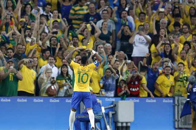 Brazil's Neymar celebrates scoring his side's first goal during the final of the men's Olympic football tournament between Germany and Brazil at Maracana stadium in Rio de Janeiro, Brazil, Saturda ...