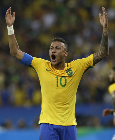 Brazil's Neymar celebrates scoring his side's first goal during the final match of the men's Olympic football tournament between Brazil and Germany at Maracana stadium in Rio de Janeiro, Brazil, S ...