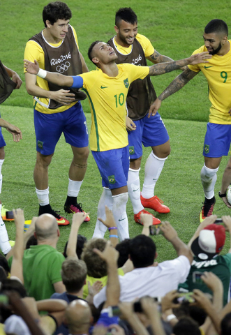 Brazil's Neymar celebrates after scoring his team's first goal on a free kick during the final match of the mens's Olympic football tournament between Brazil and Germany at the Maracana stadium in ...