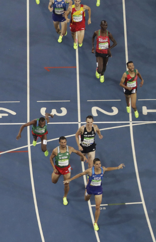 United States' Matthew Centrowitz reacts after winning a gold medal in the 1500 meter finals during the athletics competitions of the 2016 Summer Olympics at the Olympic stadium in Rio de Janeiro, ...