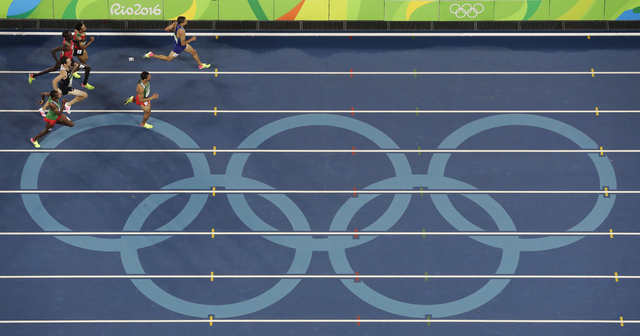 United States' Matthew Centrowitz wins a gold medal in the 1500 meter finals during the athletics competitions of the 2016 Summer Olympics at the Olympic stadium in Rio de Janeiro, Brazil, Saturda ...