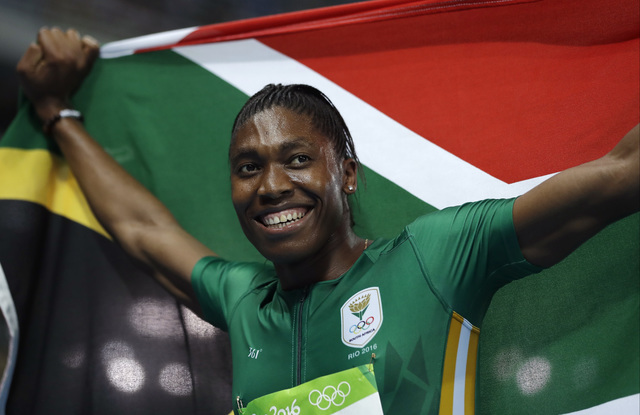 South Africa's Caster Semenya smiles after winning the gold medal in the women's 800-meter final during the athletics competitions of the 2016 Summer Olympics at the Olympic stadium in Rio de Jane ...