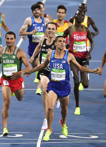 United States' Matthew Centrowitz crosses the line to win the men's 1500-meter final during the athletics competitions of the 2016 Summer Olympics at the Olympic stadium in Rio de Janeiro, Brazil, ...