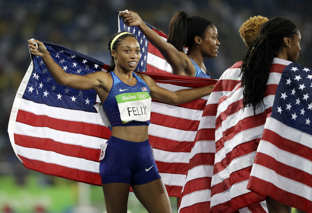United States' Allyson Felix celebrates with her teammates after winning the gold medal in the women's 4x400-meter relay final during the athletics competitions of the 2016 Summer Olympics at the  ...