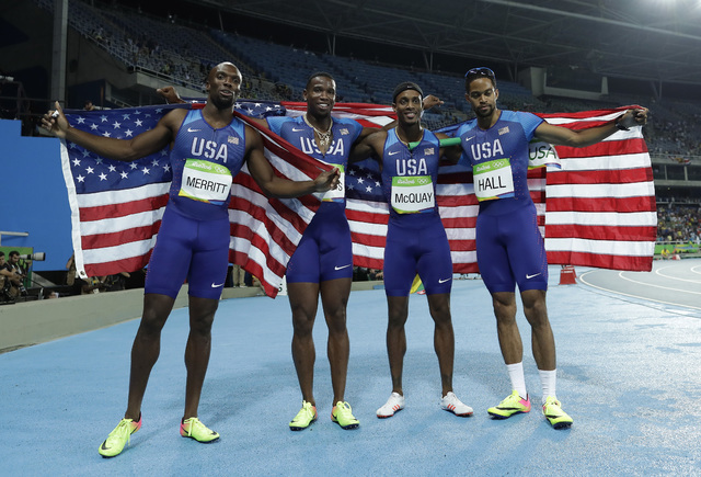 United States' Arman Hall, Tony McQuay, Gil Roberts and LaShawn Merritt celebrate winning the gold medal in the men's 4 x 400-meter medals ceremony, during the athletics competitions of the 2016 S ...
