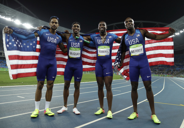 United States' Arman Hall, Tony McQuay, Gil Roberts and LaShawn Merritt celebrate winning the gold medal in the men's 4 x 400-meter relay final , during the athletics competitions of the 2016 Summ ...