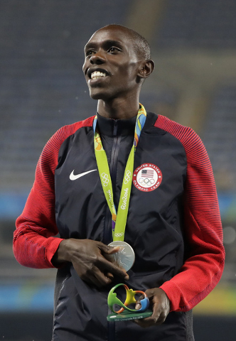 United States' Paul Kipkemoi Chelimo celebrates winning silver, in the men's 5000-meter medals ceremony, during the athletics competitions of the 2016 Summer Olympics at the Olympic stadium in Rio ...