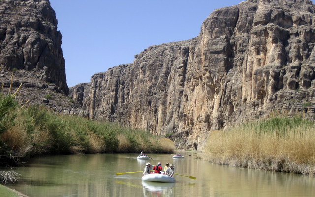 In this  March 25, 2011, file photo, rafts piloted by guides from Far Flung Outdoor Center of Terlingua, Texas, emerge from Heath Canyon, carved by the Rio Grande through Big Bend National Park, T ...