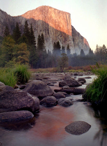In this Oct. 21, 1997 file photo, an autumn sunsets drapes El Capitan and the Yosemite valley with warm light in Yosemite National Park, Calif. First protected in 1864, Yosemite National Park is b ...