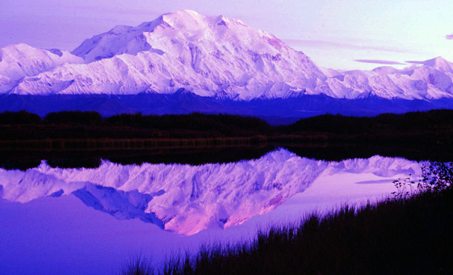 In this undated file photo, the sun sets as Mount McKinley casts its reflection on Reflection Pond at the west end of Denali National Park Road a few miles east of Camp Denali in Denali Park, Alas ...
