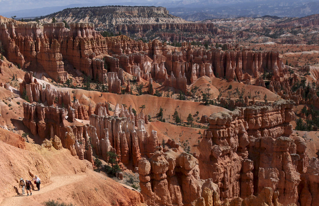 In this Sept. 6, 2009, file photo, hikers make their way to Sunset Point from Thor's Hammer in Bryce Canyon National Park, Utah. Both Zion and Bryce were formed millions of years ago when the Eart ...