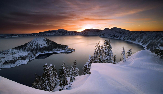 ,FILE - In this January 2006, file photo, the sun rises over Crater Lake, Ore., in Crater Lake National Park. Crater Lake lies in the caldera of an ancient volcano called Mount Mazama that collaps ...