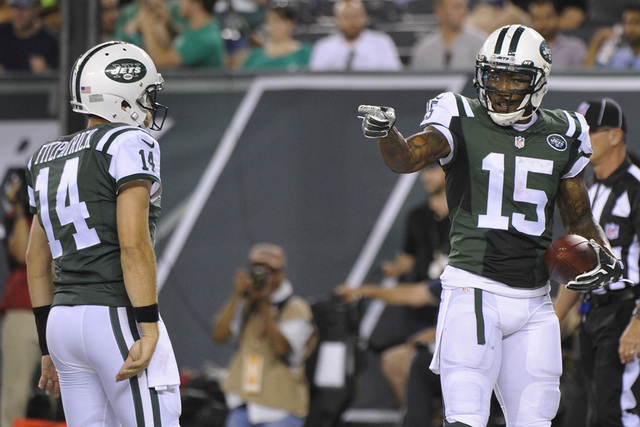 In this Friday, Aug. 21, 2015 file photo, New York Jets wide receiver Brandon Marshall (15) gestures to quarterback Ryan Fitzpatrick (14) after they scored on a two point conversion during the fir ...