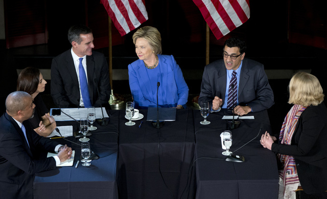 Democratic presidential candidate Hillary Clinton looks at Los Angeles Mayor Eric Garcetti, third from left, as she participates in a roundtable with Muslim community leaders at the University of  ...