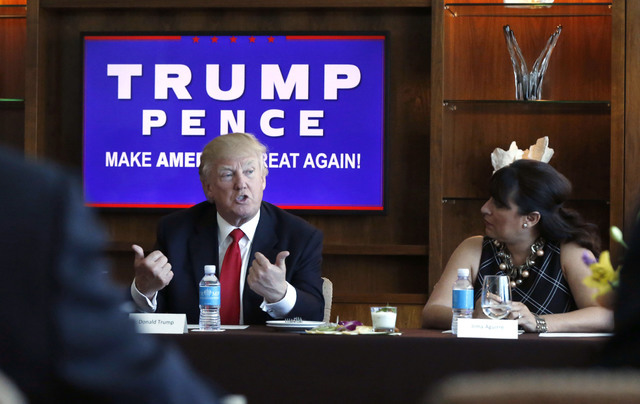 Republican presidential candidate Donald Trump leads a Hispanic leaders and small business owners roundtable in Las Vegas, Friday, Aug. 26, 2016. Right is Irma Aguirre, a local business owner. Nev ...