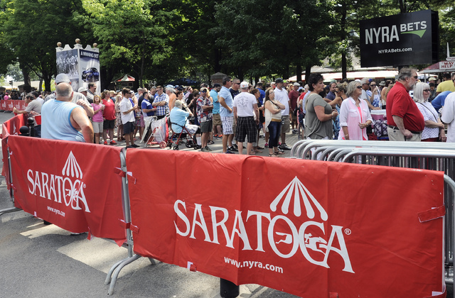 Racing fans wait for the gates to open on opening day of the season at Saratoga Race Course in Saratoga Springs, N.Y., Friday, July 22, 2016. (Hans Pennink/AP)