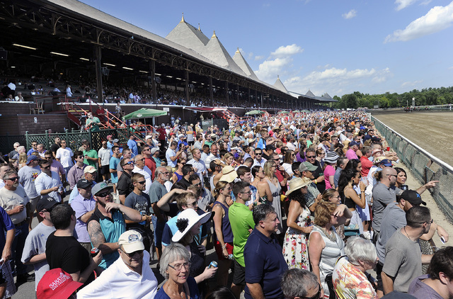 Fans watch racing action during the fifth race on opening day of the season at Saratoga Race Course in Saratoga Springs, N.Y., Friday, July 22, 2016. (Hans Pennink/AP)