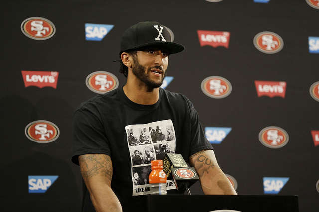 San Francisco 49ers quarterback Colin Kaepernick answers questions at a news conference after an NFL preseason football game against the Green Bay Packers Friday, Aug. 26, 2016, in Santa Clara, Ca ...