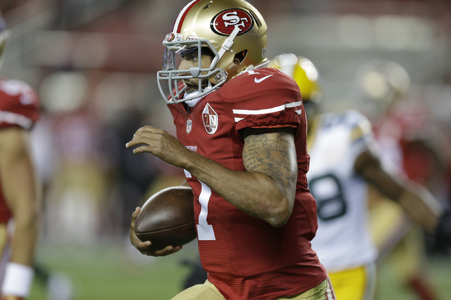 San Francisco 49ers quarterback Colin Kaepernick runs with the ball during the first half of an NFL preseason football game against the Green Bay Packers Friday, Aug. 26, 2016, in Santa Clara, Cal ...