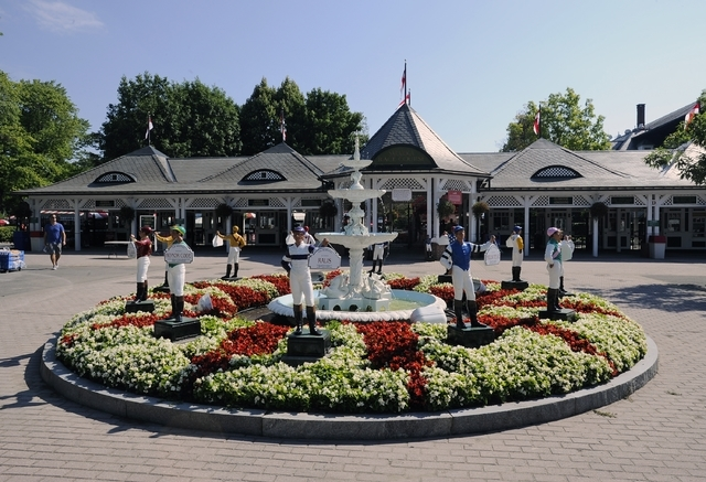 Entrance gate garden the on opening day of the season at Saratoga Race Course in Saratoga Springs, N.Y., Friday, July 22, 2016. (Hans Pennink/AP)